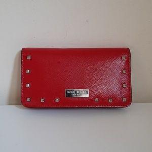 Henri Bendel West 57th studded phone case wallet
